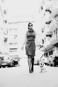 Sophisticated lady walking her dog